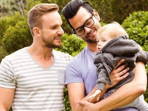 same sex couple adopts a baby